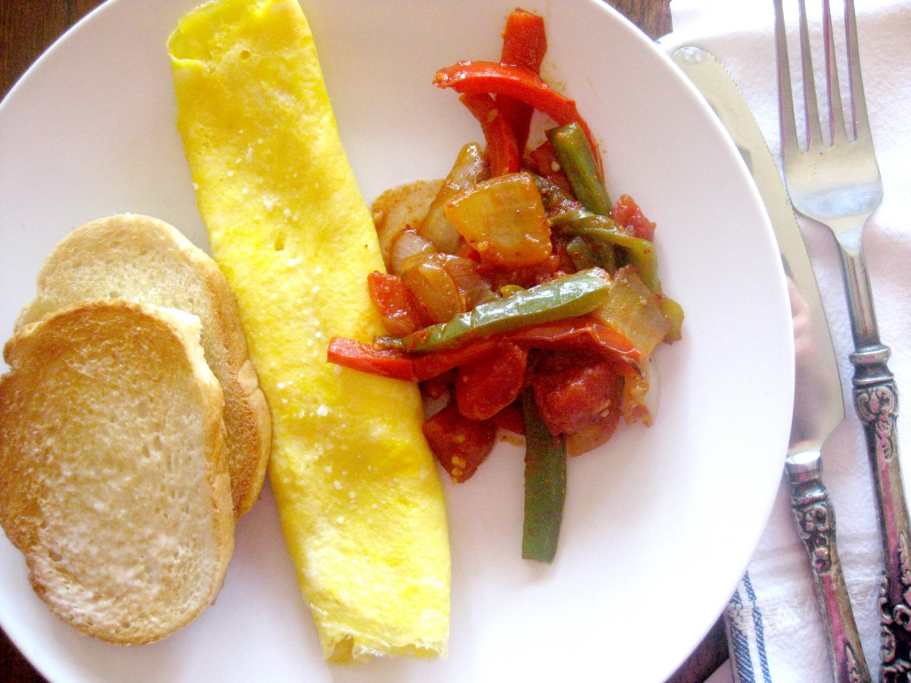 One of the many ways to serve Pipérade: With a French Rolled Omelet