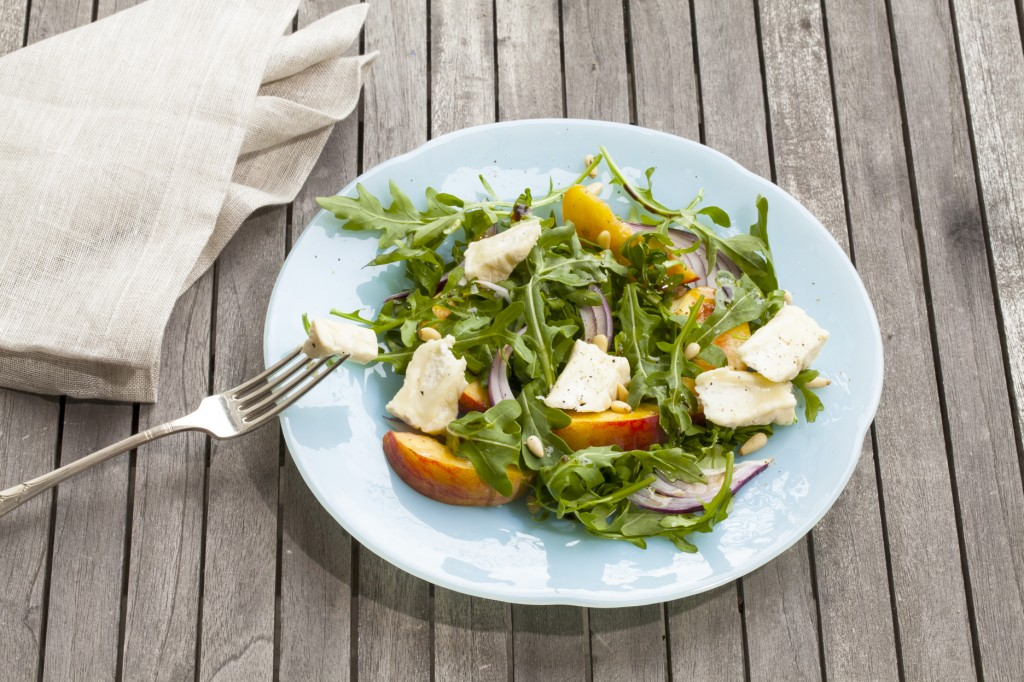 Goat cheese, peaches, and arugula star in this easy French Chevre salad. Photo courtesy of Goat Cheeses of France.