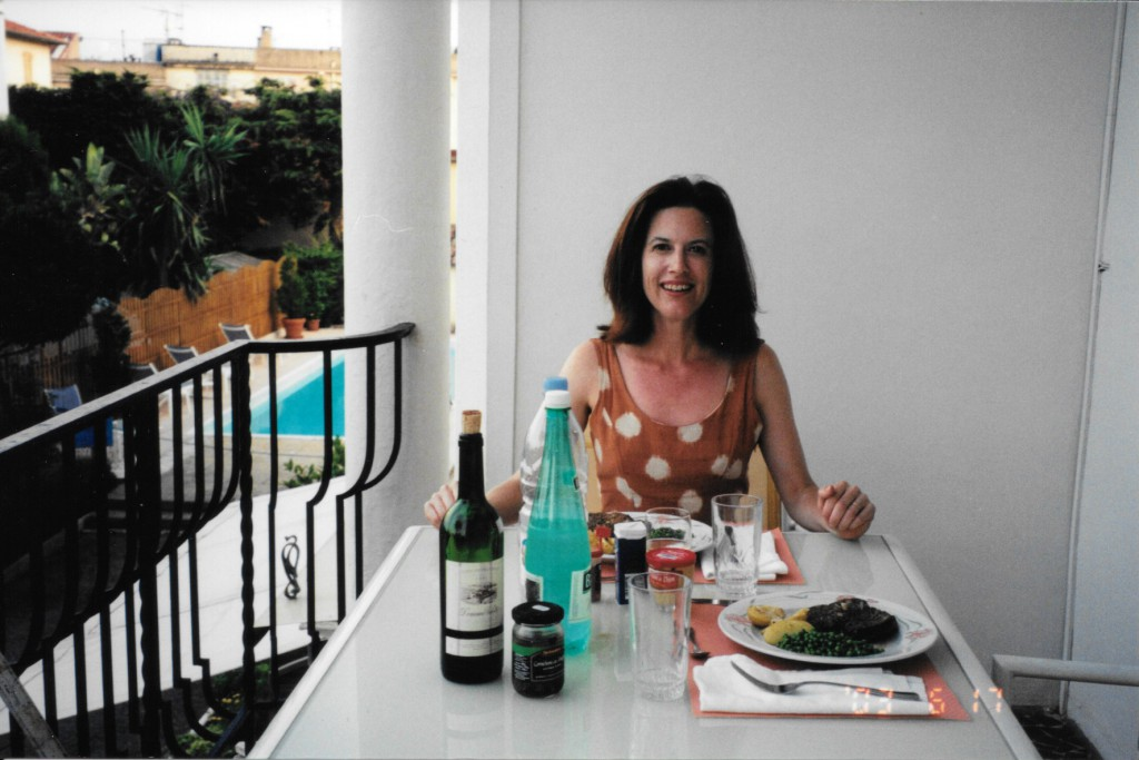 Me, on my studio balcony in St. Jean Cap Ferrat, with two of the three hangover prevention tactics. Read on!
