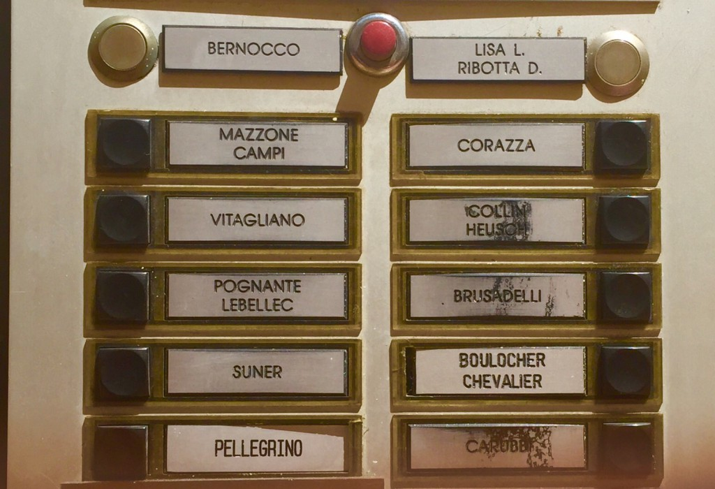 Check it out: There are more Italian names on this apartment directory than French names. No French town I've ever been in feels more Italian!