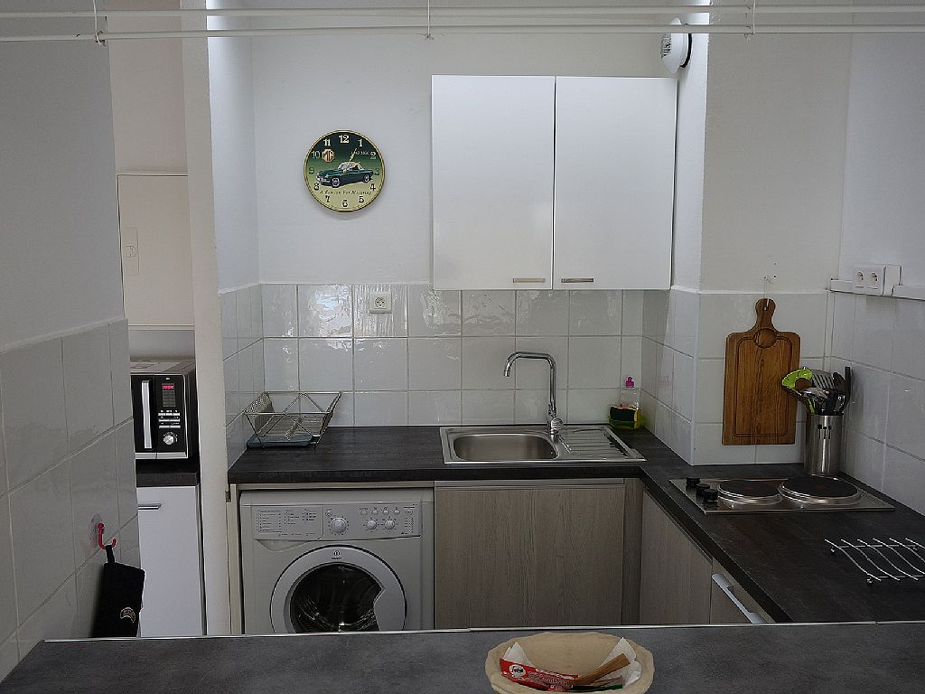 The kitchen of the apartment we're renting in Bandol. One of the things that sold me was the front-load Euro washer! Love being able to do laundry in the apartment!
